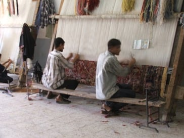 A couple of the older teenage boys weaving