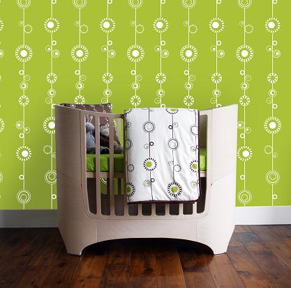 Leander cot-bed with eco-friendly wallpaper and organic bedding