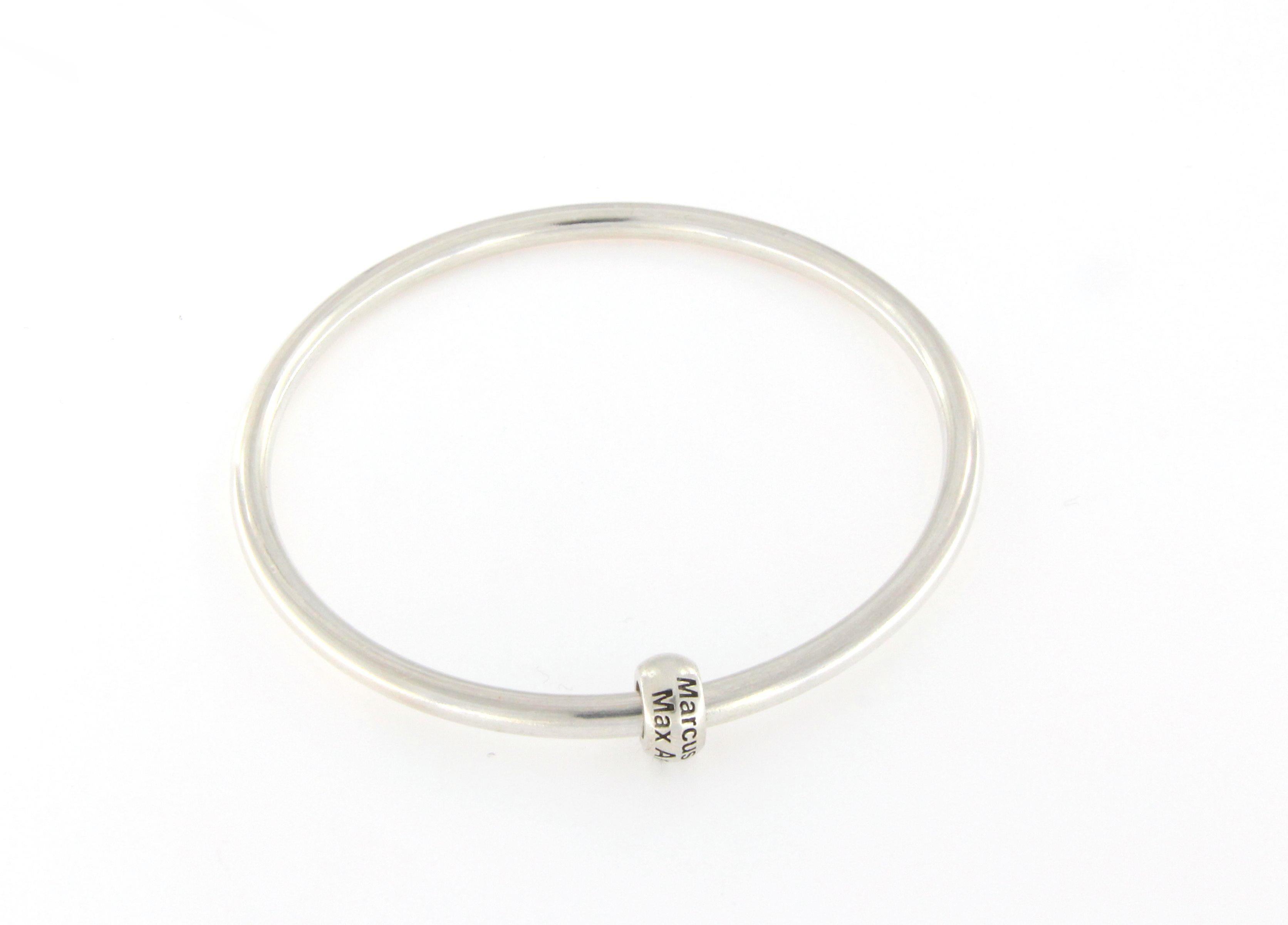 Silver bangle with family names charm