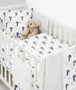 Cotbed bedding set in toadstool design
