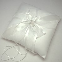 White ring cushion with Swarovski crystals in the centre