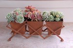 Elegant planter with three pots on rack